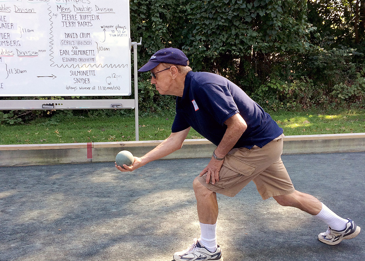 Man playing boccee ball