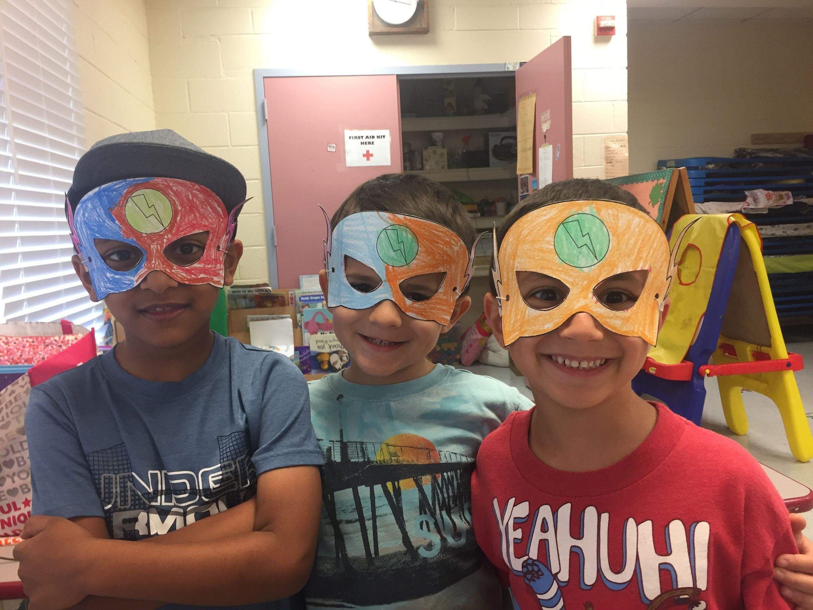 Kids wearing masks made of craft paper