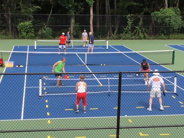 Group of people playing pickleball