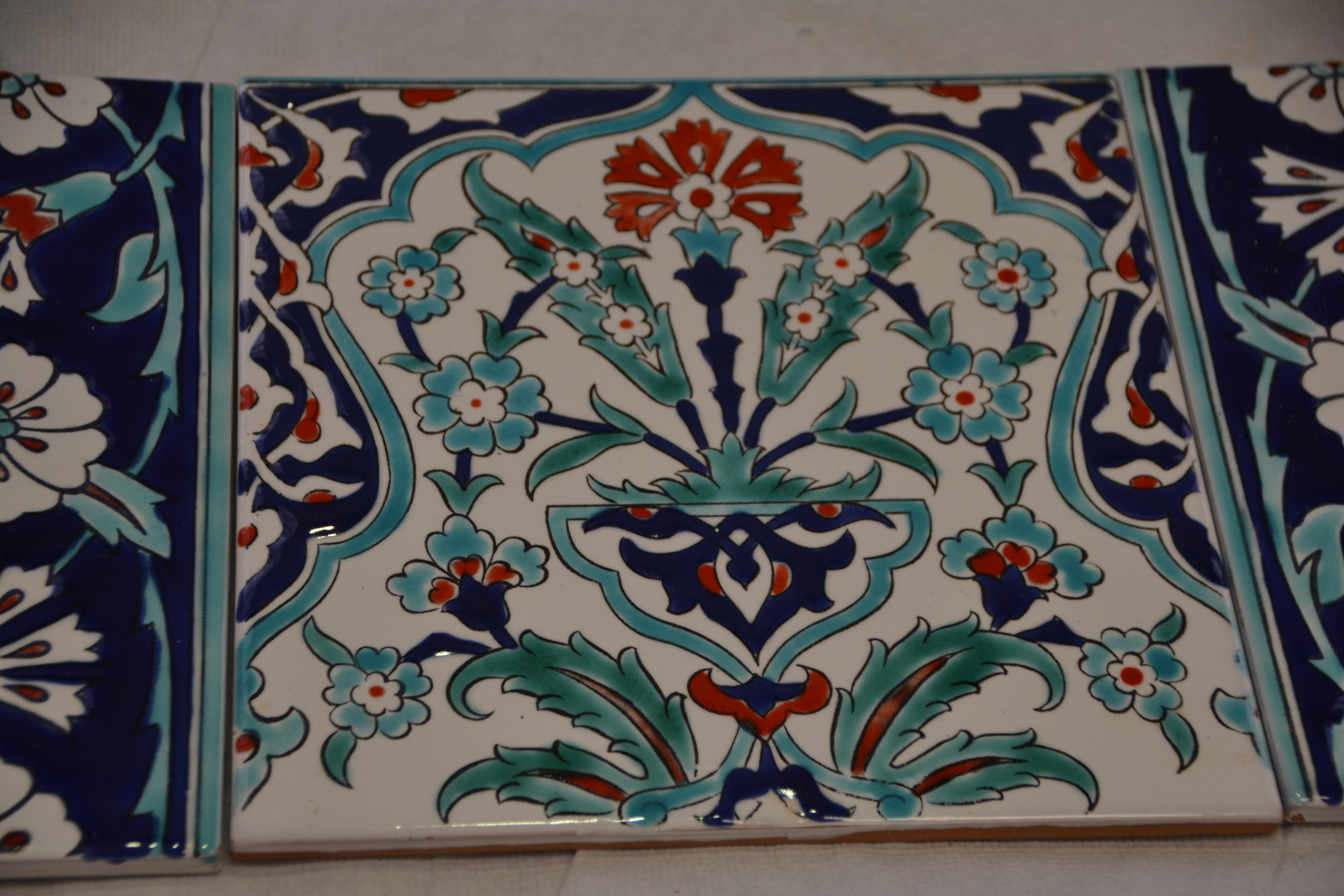 A delicate hand-painted tile.