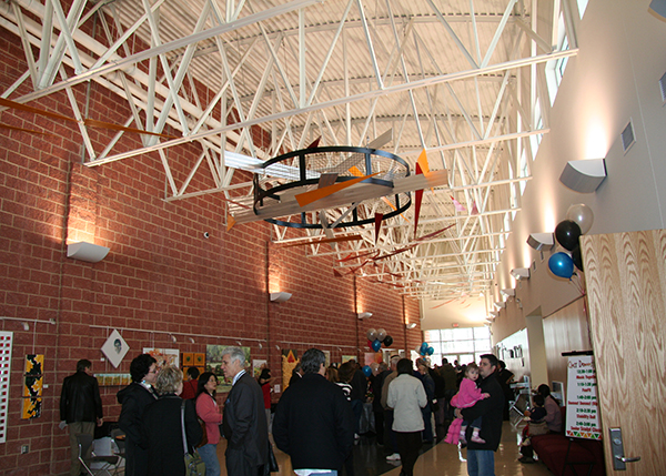 Large crowds gather in the main atrium of Thomas Farm Community Center to celebrate the opening