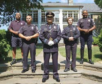 Police officers stand in a formation